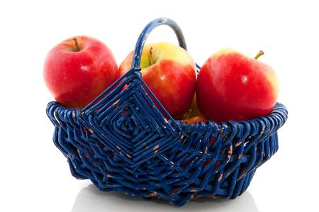 plucked: Red plucked apples in a blue basket Stock Photo