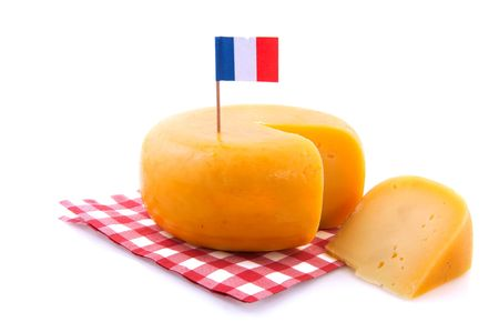 Whole French cheese with piece and flag