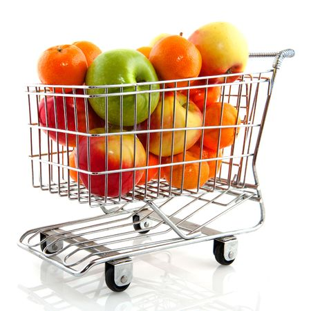 Shopping cart from the supermarket filled with fresh fruit Stock Photo - 6109129