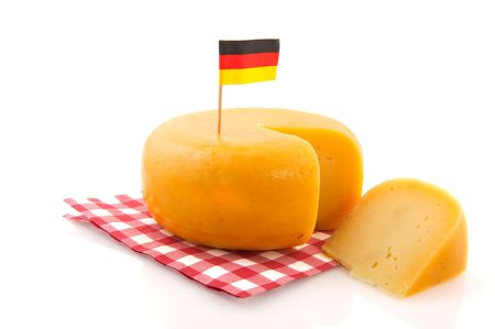 German whole cheese with flag isolated over white photo