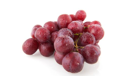 Fresh red grapes with water drops isolated over white Stock Photo - 6170888