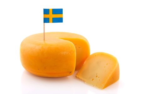 cutted: Swedish cheese with flag and cutted piece Stock Photo