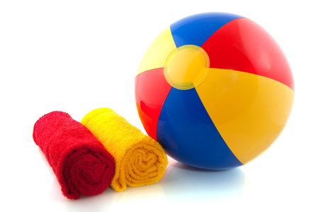 beachball: beachball and rolled towels for the summer vacation Stock Photo