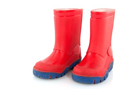 Red and blue rubber child boots for snow and rain photo