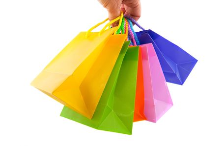 discounts: shopping with many colorful bags in the hand