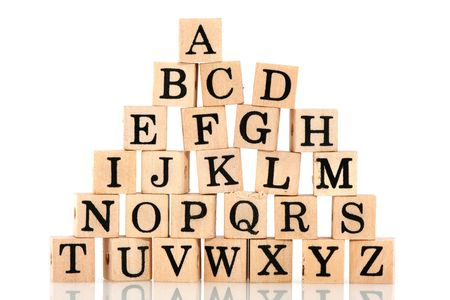 educational: all letters from the alphabet mixed on wooden blocks