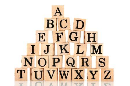 allen: alle letters van het alfabet gemengd op houten blokken Stockfoto