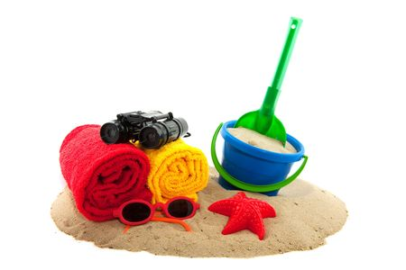 Summer vacation at the beach with towels and toys photo