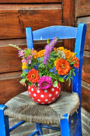 Flowers on the blue Greek chair in HDR technics Stock Photo