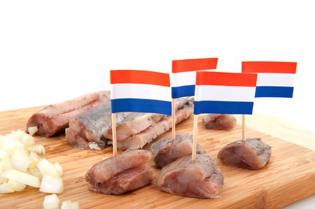 Dutch traditional raw fish herring with onions photo