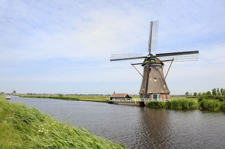 Typical Dutch landscape with windmills water and pastures Stock Photo - 6243100