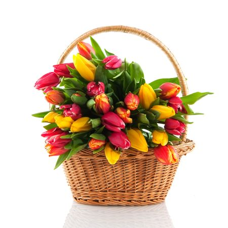 mixed flower bouquet: Cheerful basket filled with colorful bouquet tulips