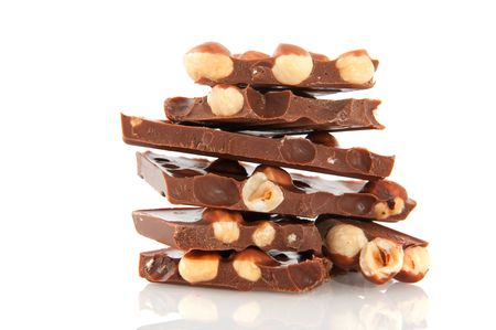 Chocolate bar with hazelnuts isolated over white photo
