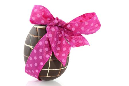 Chocolate easter egg with spotted pink ribbon photo