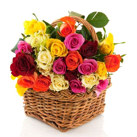 mixed flower bouquet: Basket with a bouquet of colorful roses isolated over white
