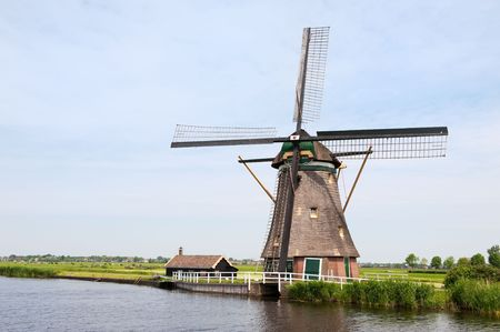 Typical Dutch landscape with windmill water and pastures Stock Photo