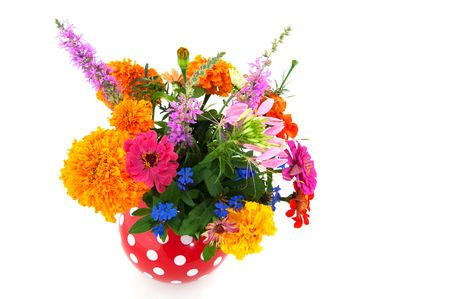 Colorful summer bouquet from the garden in spotted vase photo