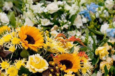 als: Many different flowers als roses and sunflowers for memoriam Stock Photo
