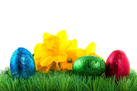 easter eggs with yellow daffodils in the grass Stock Photo - 6351755