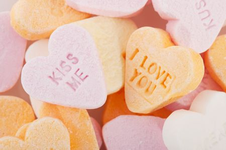 Many candy hearts with text and love you Stock Photo