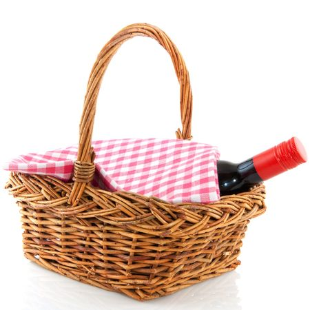 picnic basket with a bottle of wine and checkered cloth
