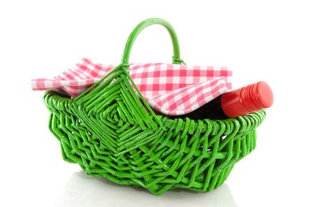 Picnic basket in green with a bottle of wine photo