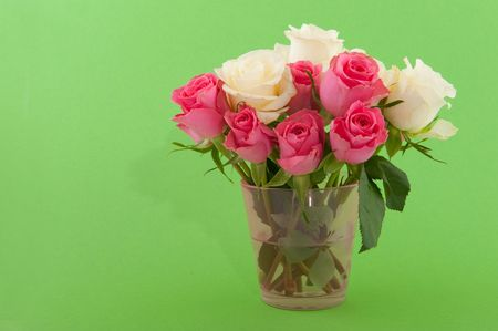 bouquet pink and white roses on green background photo