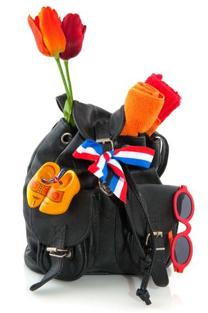 Travel in Holland with backpack flag and souvenirs photo