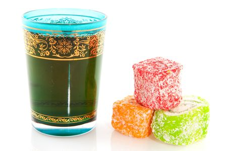 Blue glass of Turkish tea with delight photo