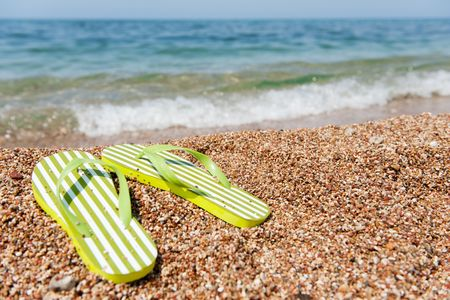 summer vacation with flip flops at the beach photo