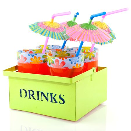 Summer lemonade with cheerful parasols in green tray photo