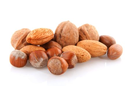 several tasty mixed different nuts isolated over white photo