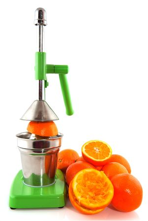 Green orange juicer is pressing the fruit  photo