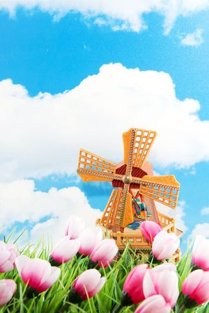 Dutch landscape with windmill and tulips in the fields Stock Photo - 6413335
