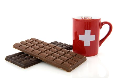 Pieces of chocolate from Switzerland isolated over white photo