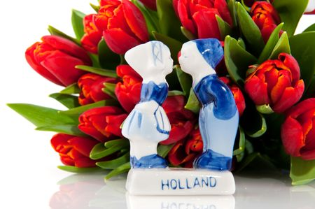 Dutch tulips with costume from Holland isolated over white photo