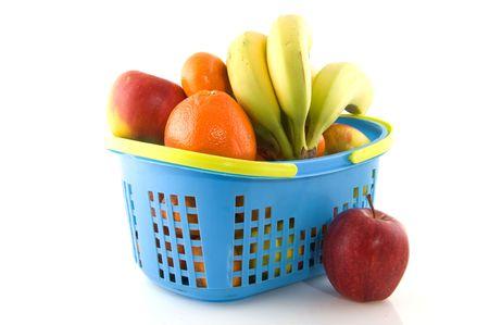 Blue shopping basket with fresh fruit isolated over white photo