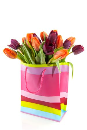 Shopping bag with a bouquet colorful tulips photo