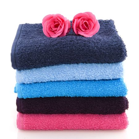 nuances: colorful folded towels in pink and blue with soap roses Stock Photo