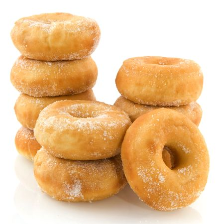 donuts: piles of donuts with sugar isolated over white