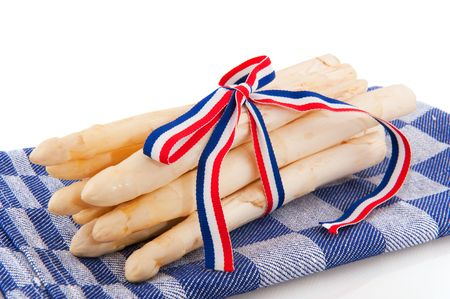 bounded: Dutch asparagus with flag ribbon on traditional cloth Stock Photo