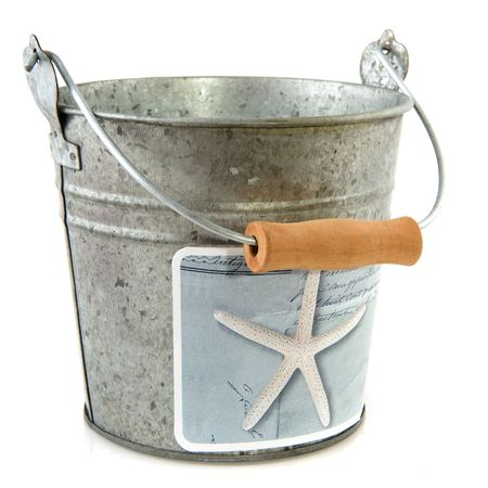 Metal beach bucket for shells isolated over white Stock Photo - 6584667