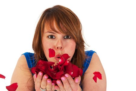 Attractive young girl with red roses and red hair photo