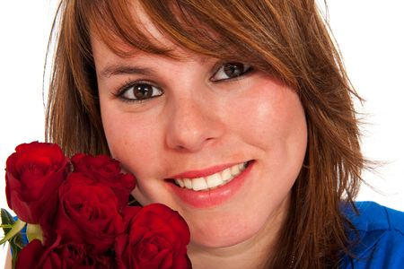 Friendly young girl with red roses and red hair photo