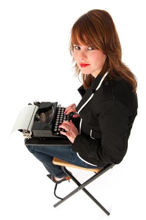 Girl with old black typewriter in funny perspective photo