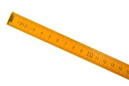 metro de medir: Wooden medici�n medidor aislado sobre fondo blanco