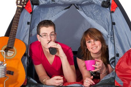 campground: Young couple at the campground in a tent Stock Photo