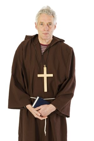 catolic: Elderly Franciscan monk with bible and cross Stock Photo