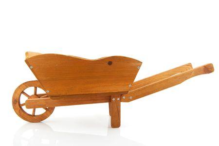 barrow: Empty wooden wheelbarrow for the garden isolated over white