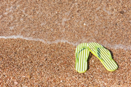 flops: Flip flops in the water line at the beach